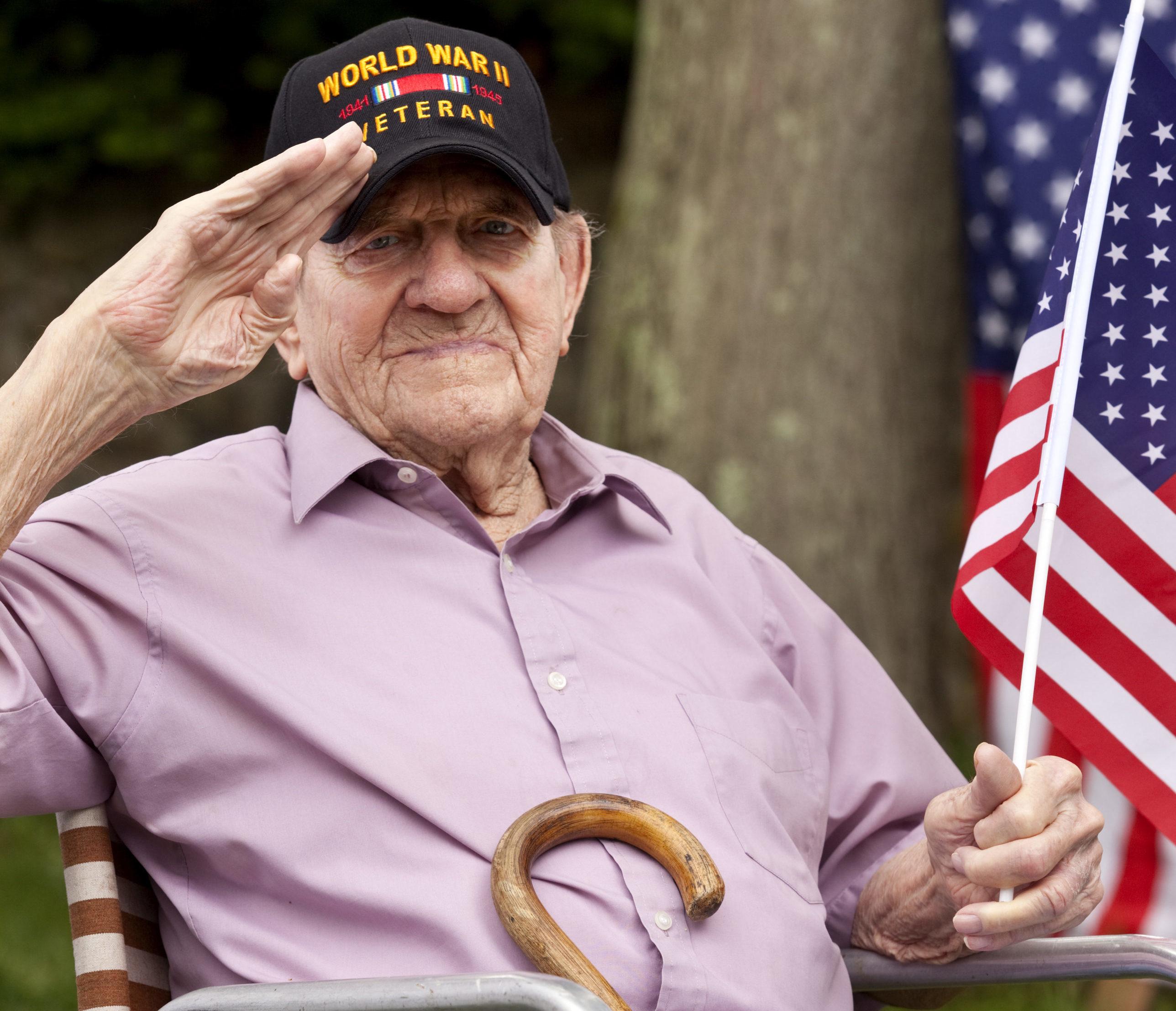 Home Health Care for Elderly Veteran Saluting US Flag